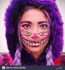 in cheshire cat costume for halloween party stock photo