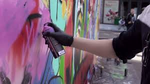 graffiti artist painting on the wall close up slow motion