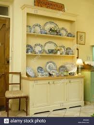 collection of blue white antique plates on cream dresser in