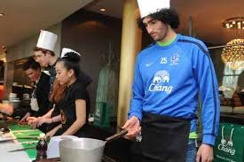marouane fellaini cooks up a storm for everton fc sponsors chang