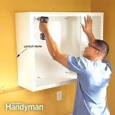 install cabinets like a pro the family handyman installing kitchen cabinets cabinet kitchen cabinet installation