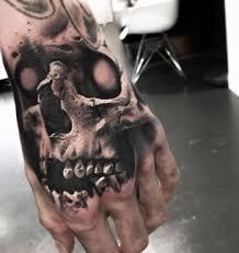 the 25 best skull hand tattoo ideas on pinterest skull tattoo