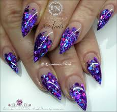 luminous nails stunning glittery indigo acrylic nails