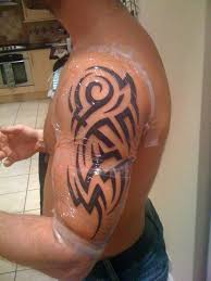 small tribal capricorn tattoo on back photos pictures and