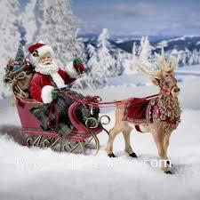 santa in sleigh with reindeer santa claus figurines and