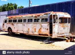an old 1950s bus being restored as a laong travel trailer at a