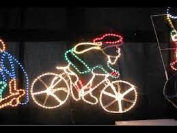 lighting display santa riding bicycle the christmas warehouse