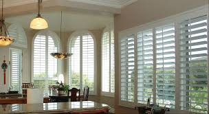 decorating plantation blinds for arched windows with pendant