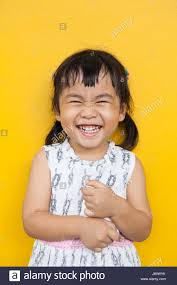 close up face of asian kid toothy smiling face with