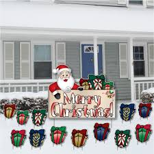 merry santa and presents lawn decoration