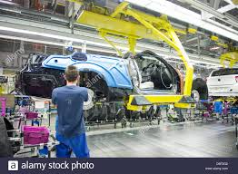 bmw factory robots an employee of car manufacturer bmw work on a car at the bmw