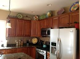 whats on top of your kitchen cabinets home decorating top of cabinet decor top cabinet decorating ideas decor kitchen