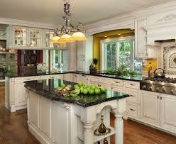 kitchen grey cabinets black kitchen countertops white backsplash