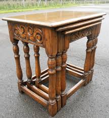 nest of three antique style oak coffee tables