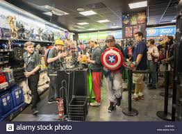 Gamestop Sales Associate A Customer With A Captain America Backpack At The Opening Of Stock