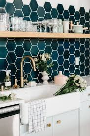copper backsplash tiles kitchen surfaces pinterest kitchen design black white and copper kitchen with blue