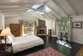 cottage guest bedroom with fireplace hardwood floors in