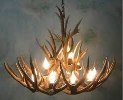 Rustic Dining Room Lighting by Dining Room 6 Light Antler Chandelier With Wooden Wall For Rustic