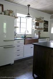 702 Hollywood The Fashionable Kitchen by Black Cabinets With White Crown Molding And Light Countertops