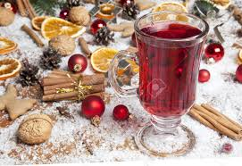 glasses of red mulled wine on table with cinnamon sticks