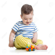 toddler toy car baby boy toddler playing with toy car stock photo picture and