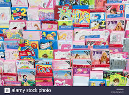 rack of birthday cards in clinton cards shop england uk stock