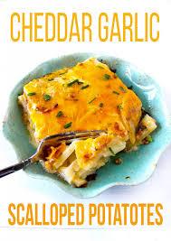 thanksgiving scalloped potatoes cheddar garlic scalloped potatoes layers of happiness