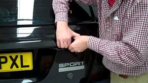 how to replace the upper tailgate panel on the range rover sport