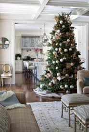 white christmas tree with gold and blue decorations ne wall