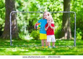 Kids Playing Backyard Football Little Kids Playing Football In Backyard