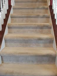 interior wooden stairs with cream carpet with stairs carpet