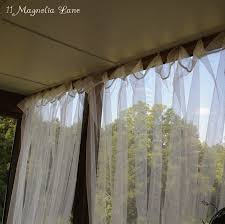 inexpensive sheer curtains add privacy to screened porch 11