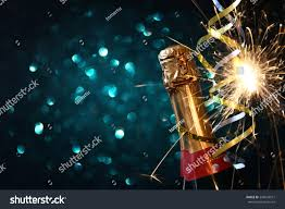 abstract image chagne bottle festive lights stock photo