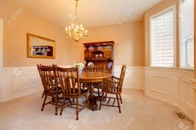soft colors dining room with carpet floor rustic dining table