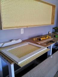 remodelaholic build an organized pegboard tool cabinet and building sliding doors for the pegboard tool cabinet featured on remodelaholic com