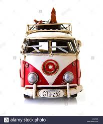 volkswagen old red old red and white van toy on a white background stock photo