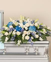 casket spray blue and white casket spray stadium flowers