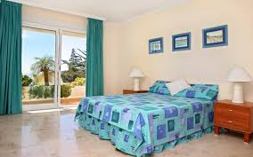 cool blue wall color with floral pattern also simple master bed