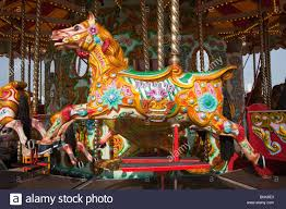 fairground merry go brighton pier uk stock