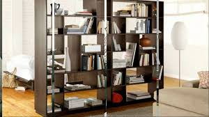 dark brown wooden books shelves as room dividers with rectangle