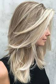 medium length lots of layers hairstyles medium length hairstyles we re loving right now southern living