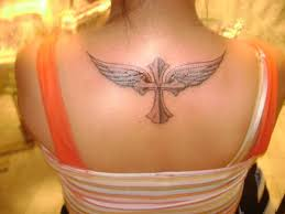 wings tattoo on shoulder blade