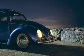 blue volkswagen blue volkswagen beetle car near cliff during night time free