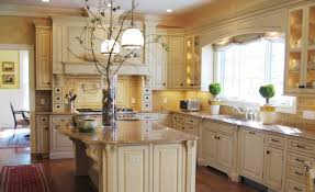sand colored granite for antique white kitchen cabinets with classic lighting fixtures