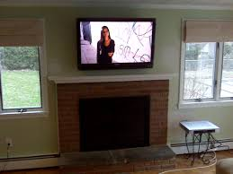 bloomfield ct u2013 lg tv over fireplace with wires outside of wall