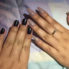 natural rounded nails with a black matte polish and a full set of