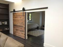 unusual sliding wooden indoor doors on white painted wall between