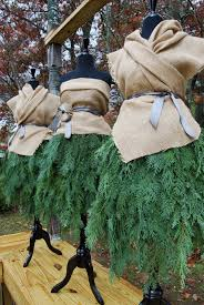 mannequin in leyland cypress and burlap holidays pinterest