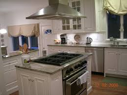 range in kitchen island cupboards on either side of range to make an island for the