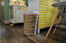 hidden laundry hamper trash talk create a top secret hiding space for your unsightly